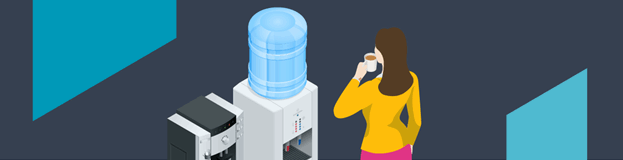 Woman in yellow top drinking a hot drink in front of a water filter and coffee machine